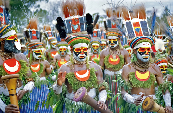 Papua New Guinea locals dressed in traditional garb
