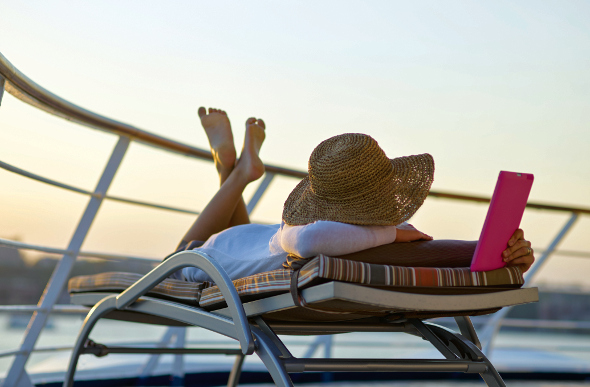 Woman reading on a lounger on a cruise ship