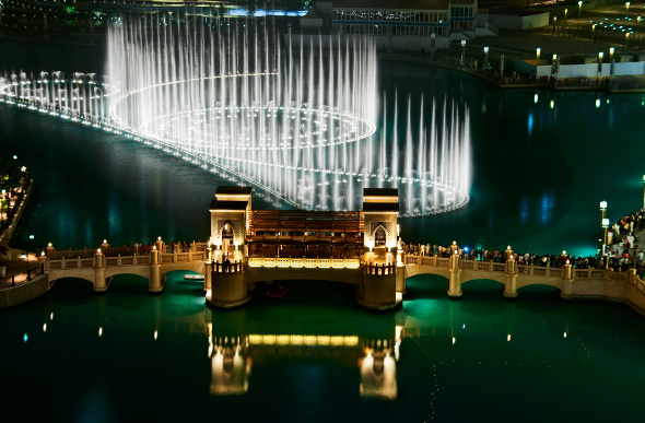 Illuminated jets of water dance at Dubai Fountain.