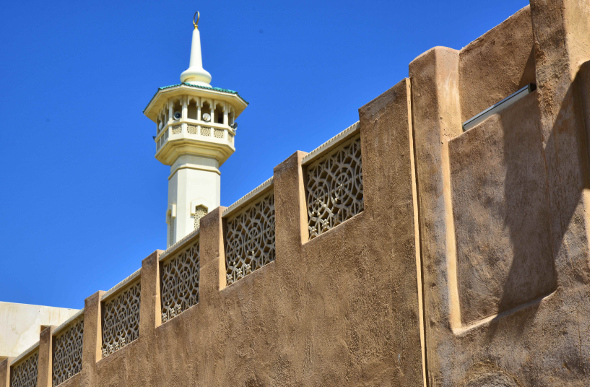 A minaret looms above the low-rise area of Al-Fahidi