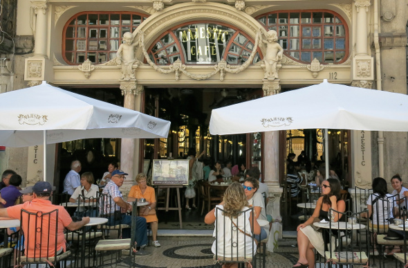 People dining at Majestic Cafe in Porto