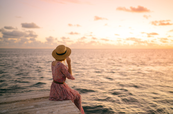 Emilie Ristevski watches the sunset at Hardy Reef from the Reefworld pontoon in the Whitsundays.