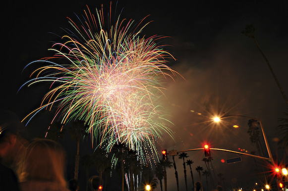 Bastille Day fireworks with palm trees.