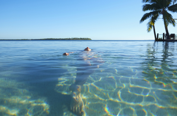 Woman swimming in Fiji