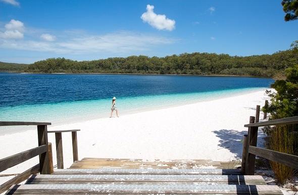 Woman walking at Lake Mckenzie, Fraser Island, Australia.