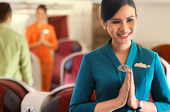 Garuda Indonesia staff greet passengers.