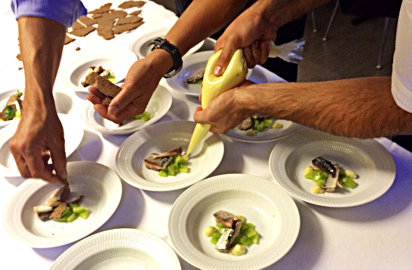 Chefs plate up mackerel in Copenhagen, Denmark.