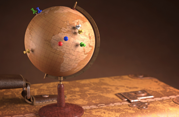 A globe with pins in it
