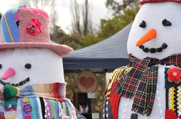 A decorative foam snowman and snowwoman.