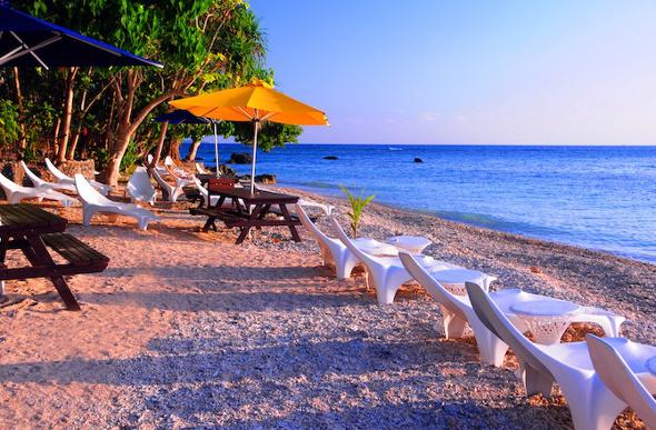 Beach chairs near the ocean on Hideaway Island