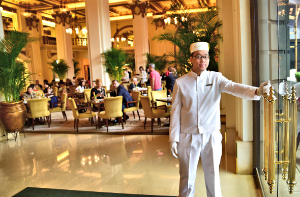 A fancy doorman at High Tea at Peninsula Hotel