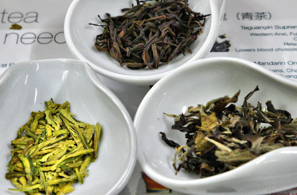 Three bowels of fresh tea leaves in Hong Kong