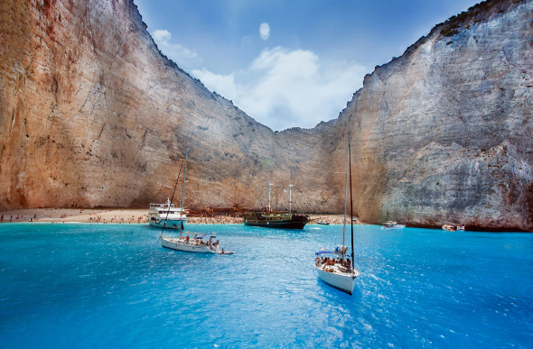 Boats moored in a private cove with shipwreck