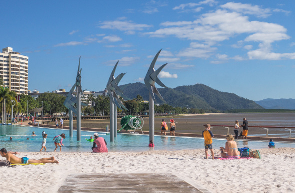 Children play in the lagoon at Cairns Esplanade.