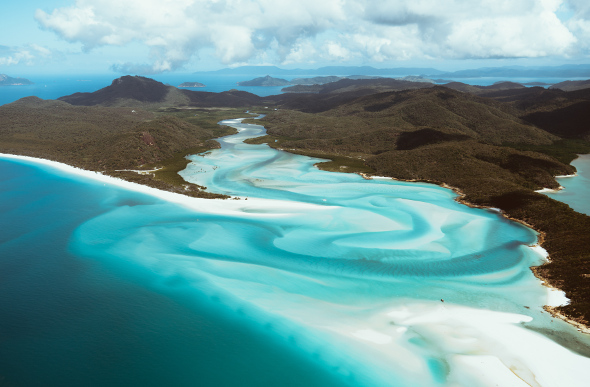 The swirling sands and waters of Hill Inlet in the Whitsundays viewed  from the air.