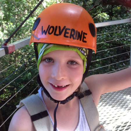 A young daredevil kitted out and raring to go on a Jungle Surfing Canopy Tour of the Daintree rainforest.