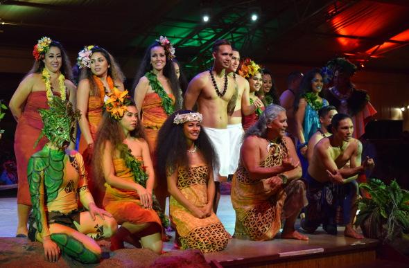 Wearing traditional Hawaiian dress, the cast of Luau Kalamaku take a bow at Kilohana Estate and Plantation on Kauai.