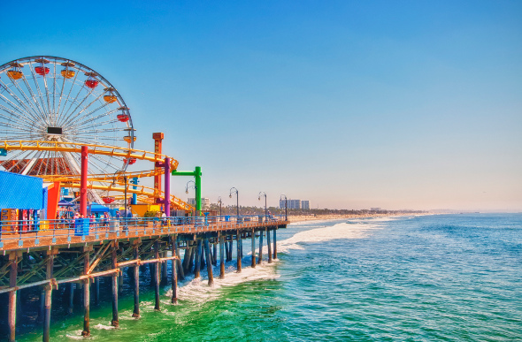 A Ferris wheel and amusement rides at Santa Monica pier, Los Angeles.