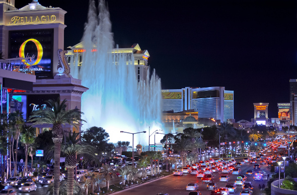 Cars driving past the Bellagio fountain in Vegas