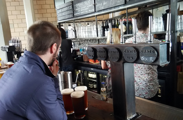 A man ordering pints of craft beer at Crate Brewery