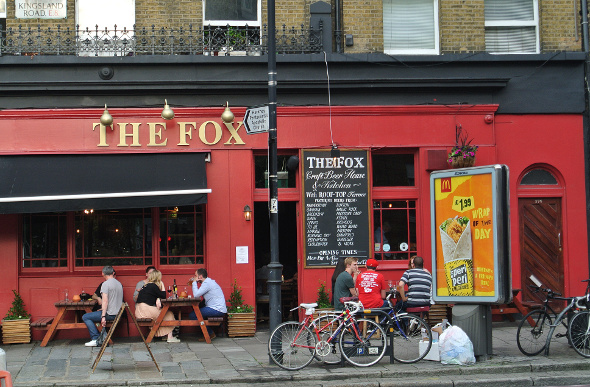 People sitting outside The Fox craft beer bar in London