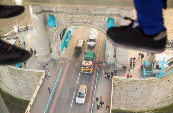 Looking down at London traffic from Tower Bridge's glass floor.