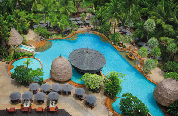 An inviting pool in the lush tropical gardens of the Movenpick Resort & Spa Karon Beach in Phuket, Thailand.