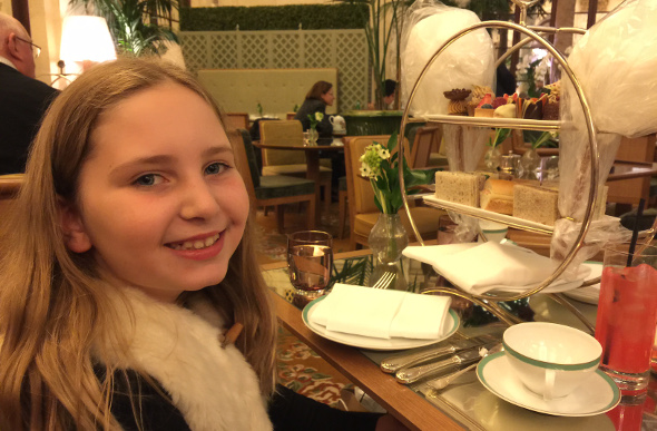 A young girl enjoys Eloise-themed high tea at The Plaza hotel in New York.