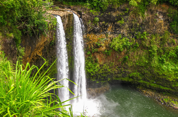 Manawaiopuna Falls is otherwise known as 'Jurassic Park Falls'. Picture: Getty Images