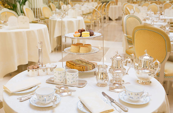 Silverware and tasty treats are poised for afternoon tea at the Ritz London.