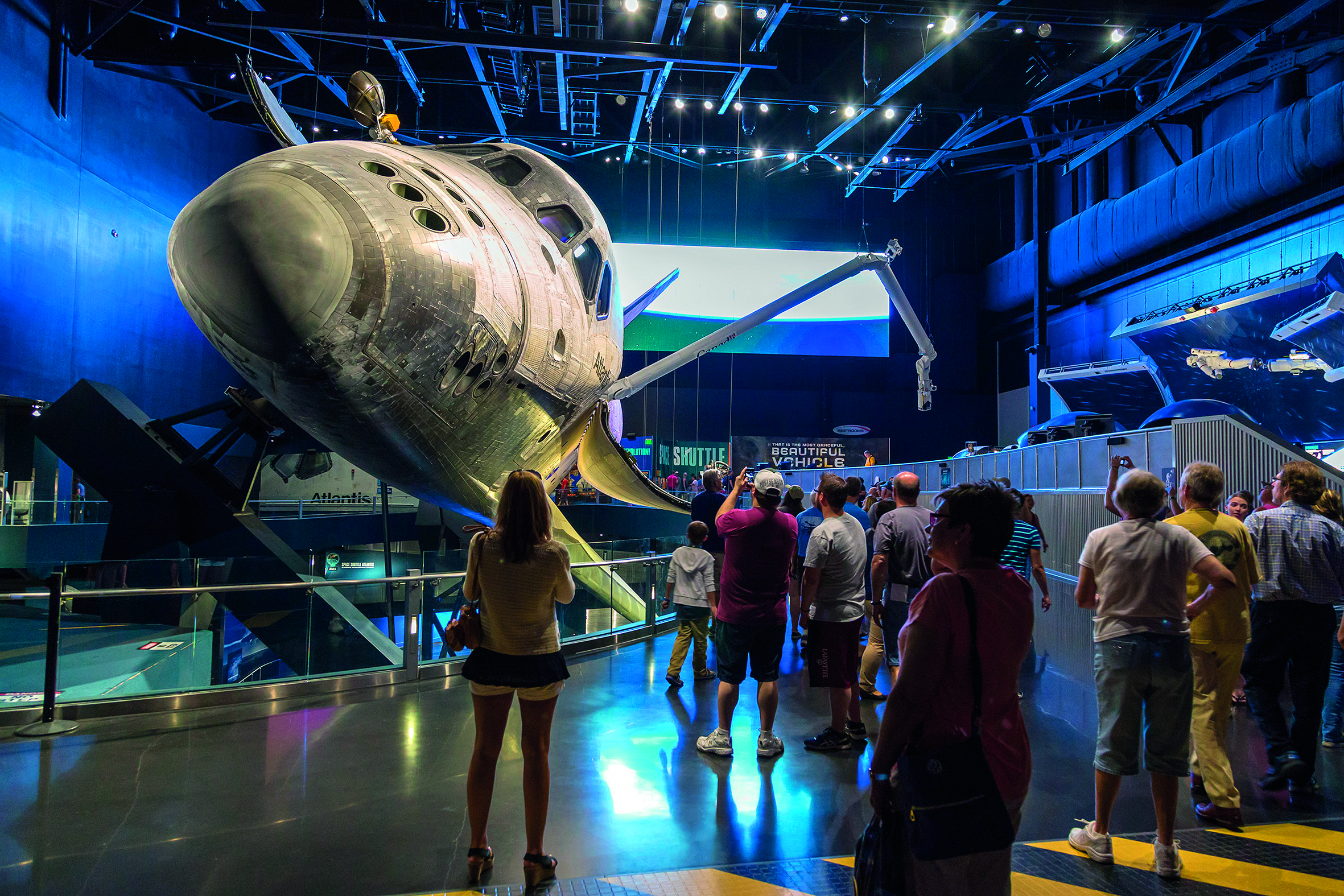 Adults and children alike marvel at the Space Shuttle at the Kennedy Space Centre.