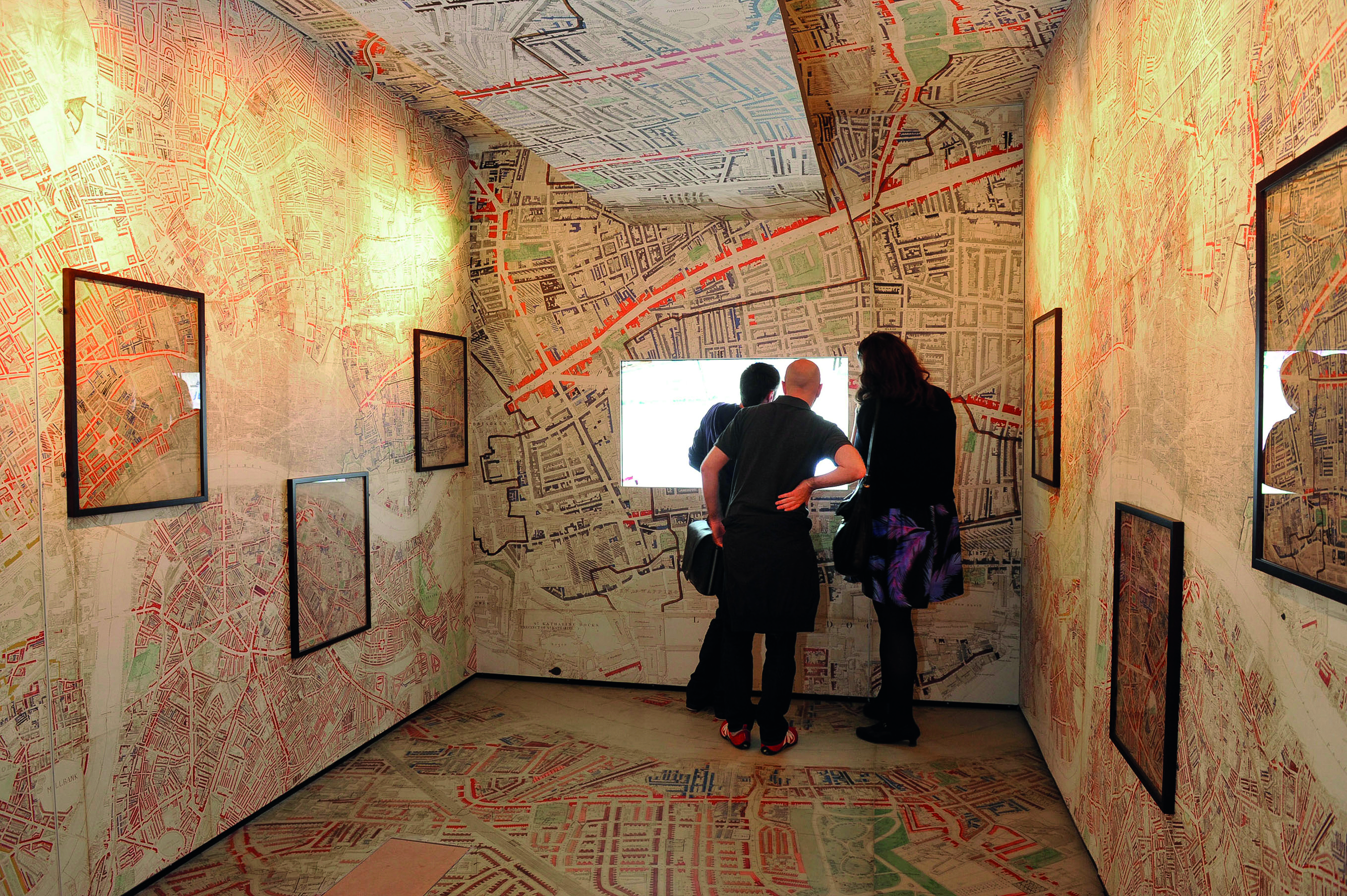 Maps line the walls, ceiling and floors of the Museum of London.