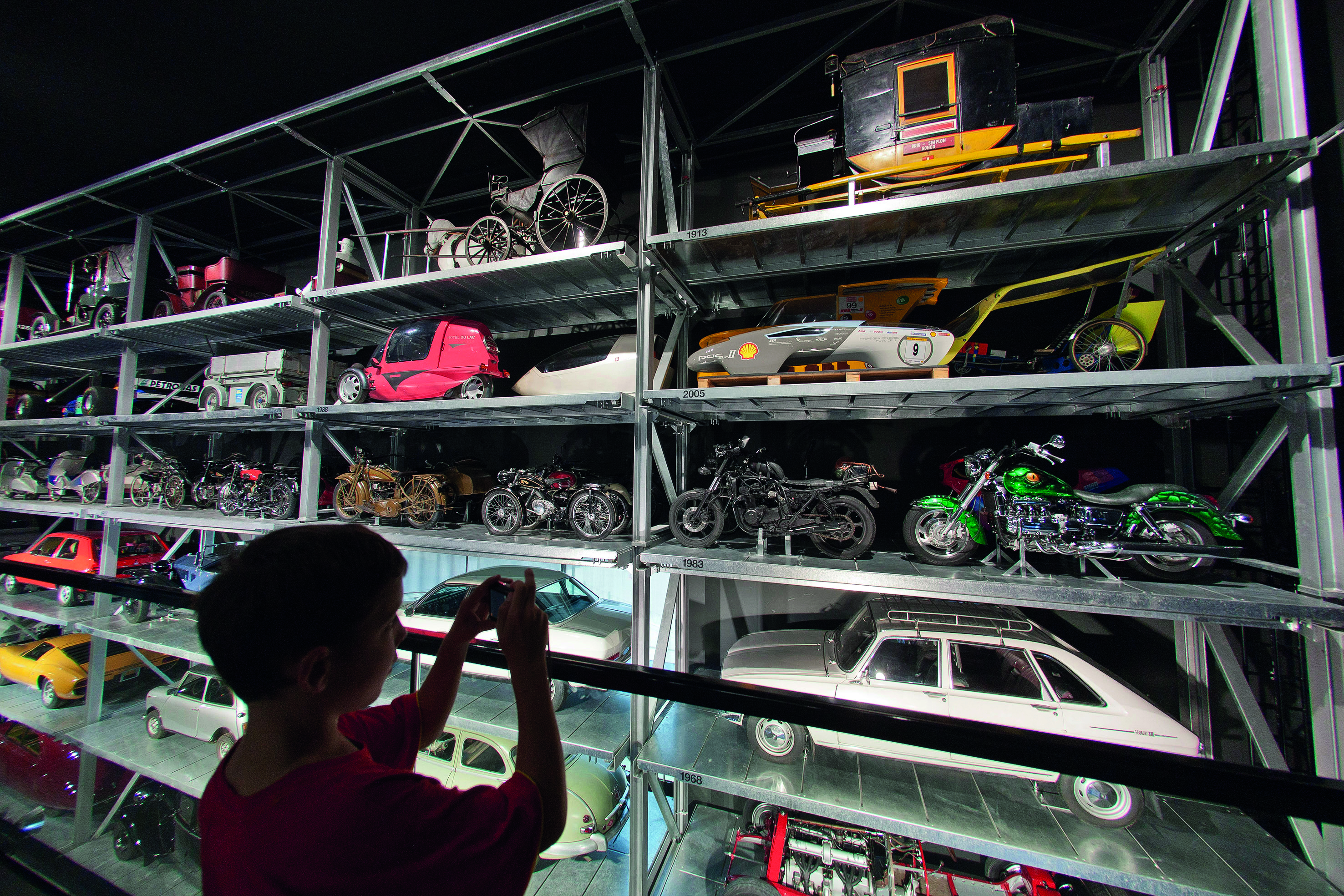 A child admires toy cars at the Swiss Museum of Transport.