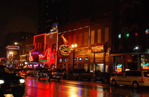 Nashville street with neon-lighted honky tonk bars