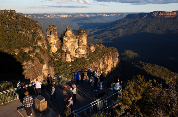 A group of people admiring the Blue Mountains
