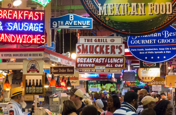 Signs jostle for position at Reading Terminal Market in Philadelphia.
