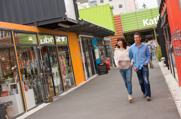 A couple wander through the Re:START shipping container mall in Christchurch, New Zealand.