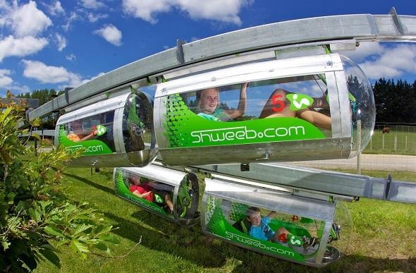 Kids having fun in the Shweeb racing pods.