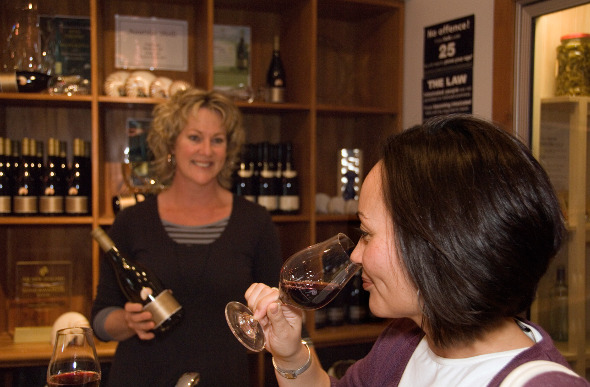A woman tastes wine at a cellar door in Marlborough, New Zealand.