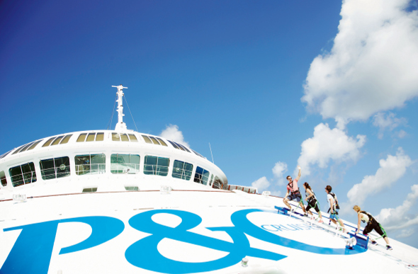 Passengers climbing the bow of a cruise ship