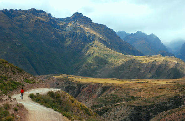 A lone mountain biker rides through the Sacred Valley of Peru.