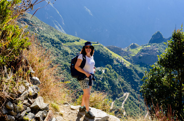 A woman admires the view on a trek through the Sacred Valley of Peru.
