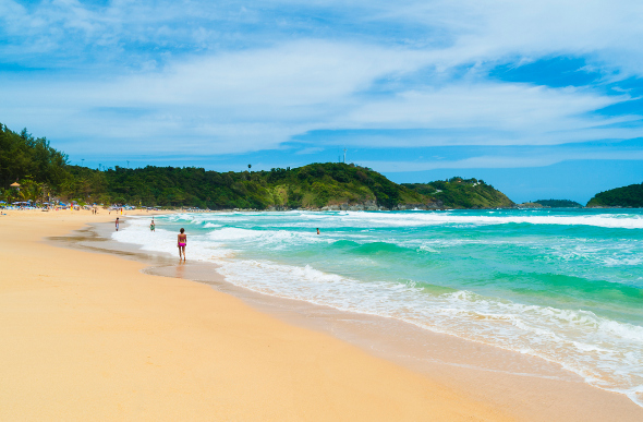 Yellow sand and bright blue water on Nai Harn Beach