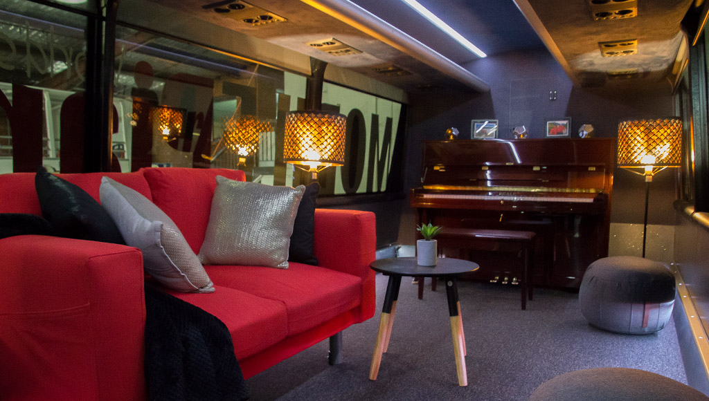 A look inside the AAT Kings travelling piano bar complete with lounge, ottomans and ambient lighting.