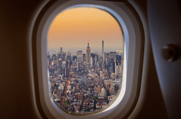 A view of Manhattan, New York, through a plane's window.