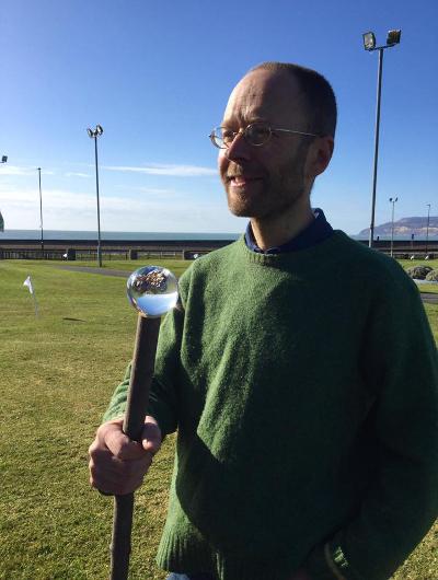Daniel Roberts holding a poo specimen
