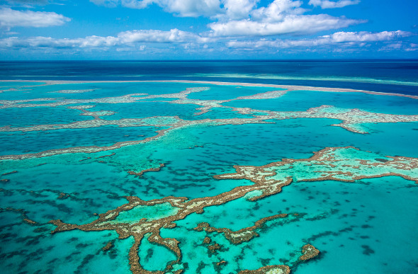 The Great Barrier Reef makes patterns around the Whitsundays. Picture: Getty Images