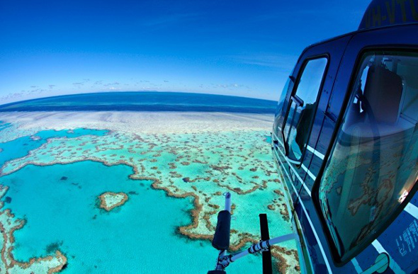 The view from a helicopter over the Great Barrier Reef in the Whitsundays.