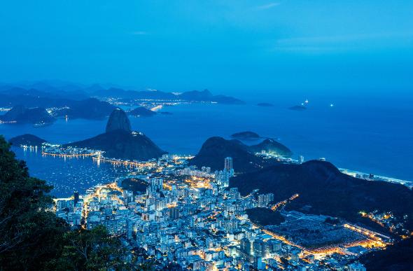 The city skyline of Rio de Janeiro at night.
