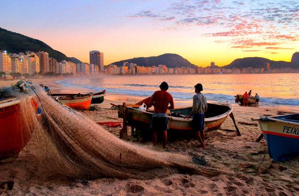 Fisherman on Copacabana Beach in Rio de Janeiro, Brazil, at sunrise.